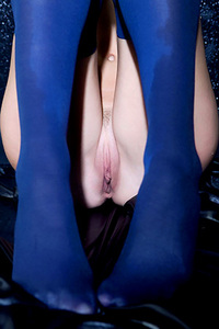 Young Brunette in Sexy Blue Stockings