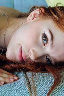 Sensual Redhead Jia Strips Down Naked
